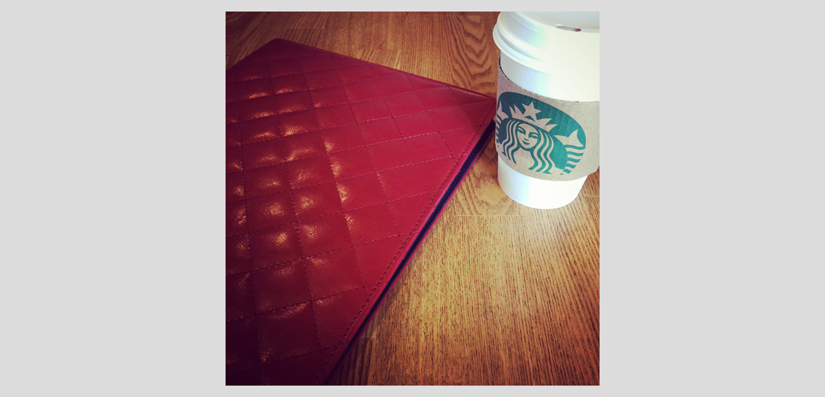 fingerprint design's photo of her sketchpad and coffee at a client meeting